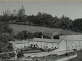 Postcard photograph of Church Hill with the Manor House on the hill and the Quarry Cottages below 1930 - cneta0n200ke